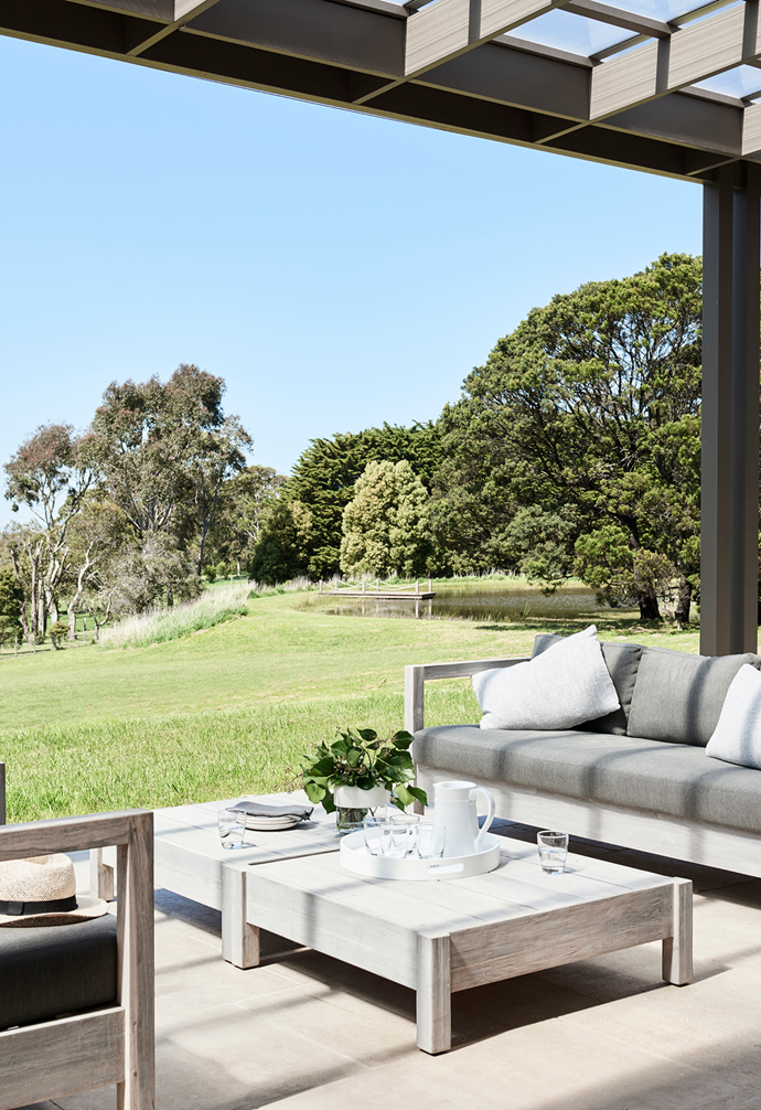 The family like to relax on 'Marina Cube' sofas by Globe West in the alfresco zone.