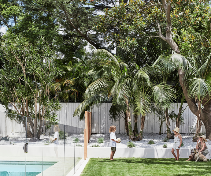 Kristin opted for a low-maintenance garden of palms, succulents and rosemary, with fluffy Zoysia grass, white crushed gravel and white rendered walls completing the look. She did the painting herself, using a creamy white colour to add warmth and avoid intense reflection. Landscaping by Hollandscapes.