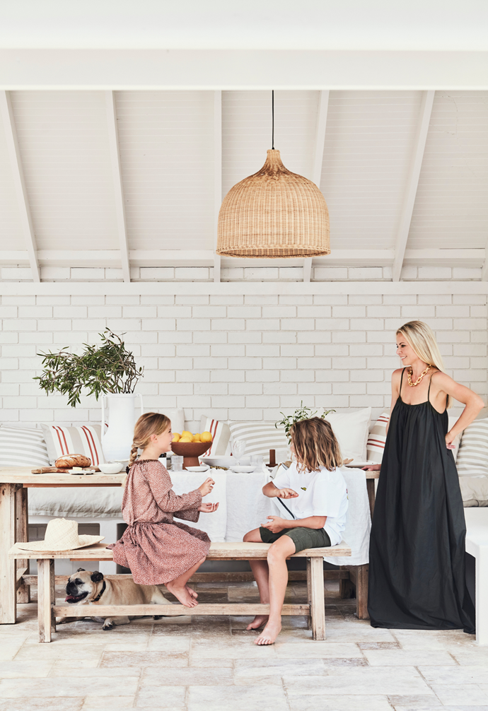 For the undercover area, Kristin selected a dining table and bench from Early Settler, pendants from GlobeWest and a white linen tablecloth from Carlotta + Gee.