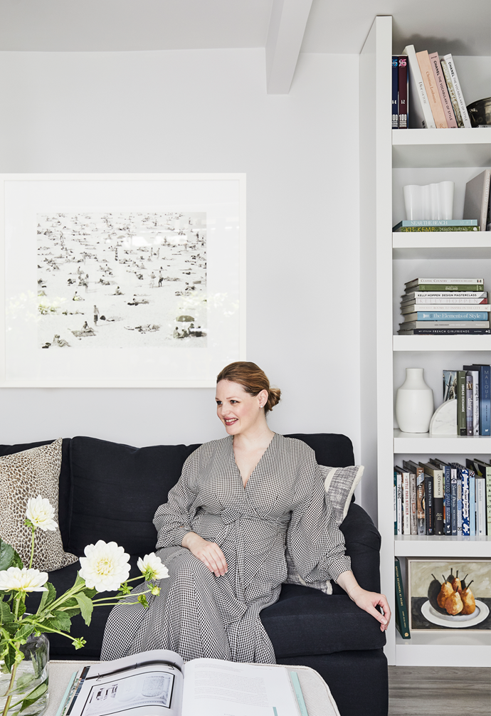 """""""Australian style has come about as a reaction to who we are, and where and how we live,"""" says Elle, pictured at home. Her sofa in Elliott Clarke 'Para' fabric contrasts the walls and shelves in Dulux's Lexicon Quarter. Leopard print cushion in Nina Campbell 'Bagatelle Weave'; stripe cushion from Freedom. Vases and objects are Iittala and Freedom. Catherine Hickson painting from Art2Muse."""