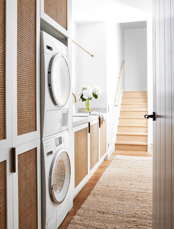 Custom laundry joinery by Hugh-Jones Mackintosh paired with Miele appliances from Winning Appliances and a beautiful warm rattan and white natural colour scheme create a Mediterranean ambience in the laundry of this casually sophisticated home on Sydney's lower north shore.