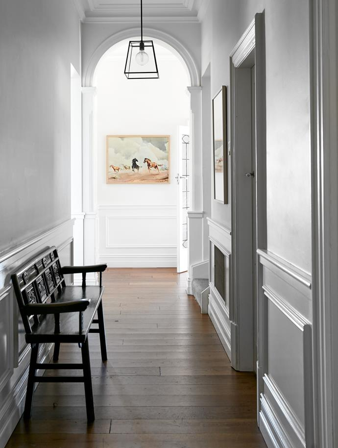 The decorative wainscoting was added in the 2010 renovation. Antique Chinese bench seat, Orient House. Vintage artwork.