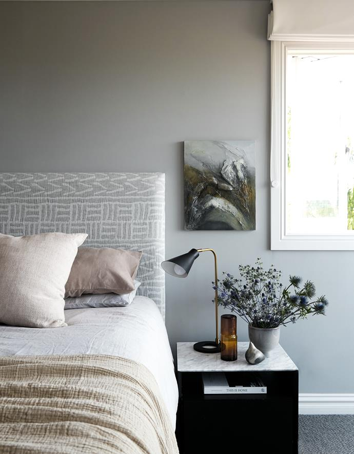 Bedhead upholstered in Rossetti Fabrics 'Impala' fabric. Alva armchair, Sarah Ellison. Bedside table, King. Table lamp, Bloomingdales Lighting. The South Revisited painting by NZ artist and family friend Margaret Woolley.