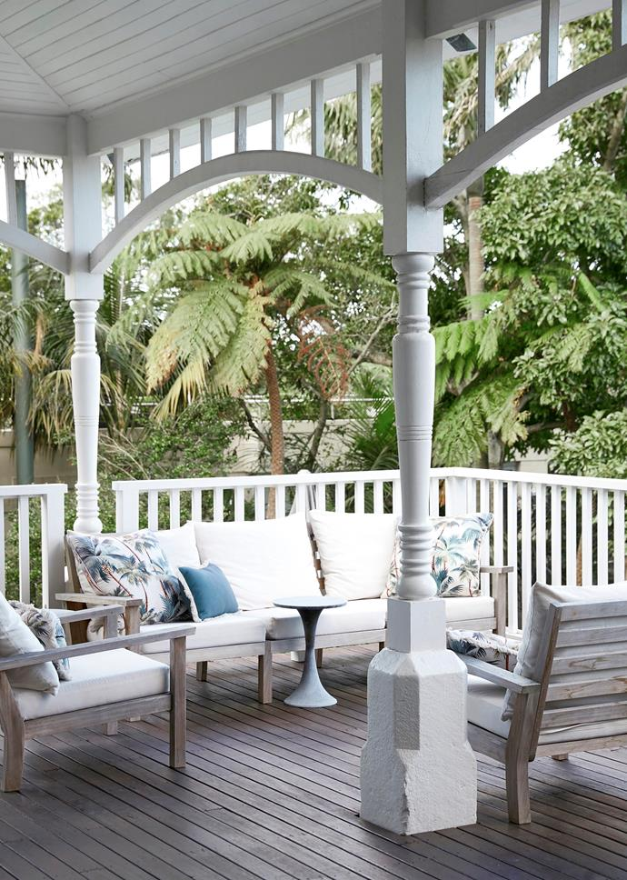 """""""It's a great spot to entertain friends or simply watch the light change on a summer's evening,"""" says Anna. Sofa setting, Wintons Teak. Cushions, Berry Jam Sweet Living. Side table, Coco Republic."""