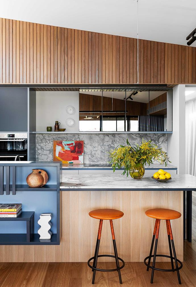 """**Kitchen** Creating a new skillion roof was the brainchild of designer Alexandra Marrotte. The facing battens are blackbutt timber with a Grey Mist stain. Underneath, the polyurethane cabinetry is a mix of [Dulux](https://www.dulux.com.au/