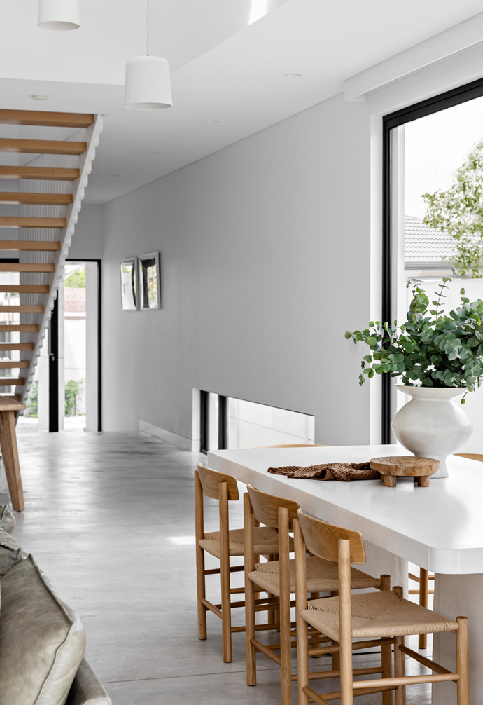 """The home's contemporary and [casual dining space](https://www.homestolove.com.au/relaxed-dining-area-ideas-3675