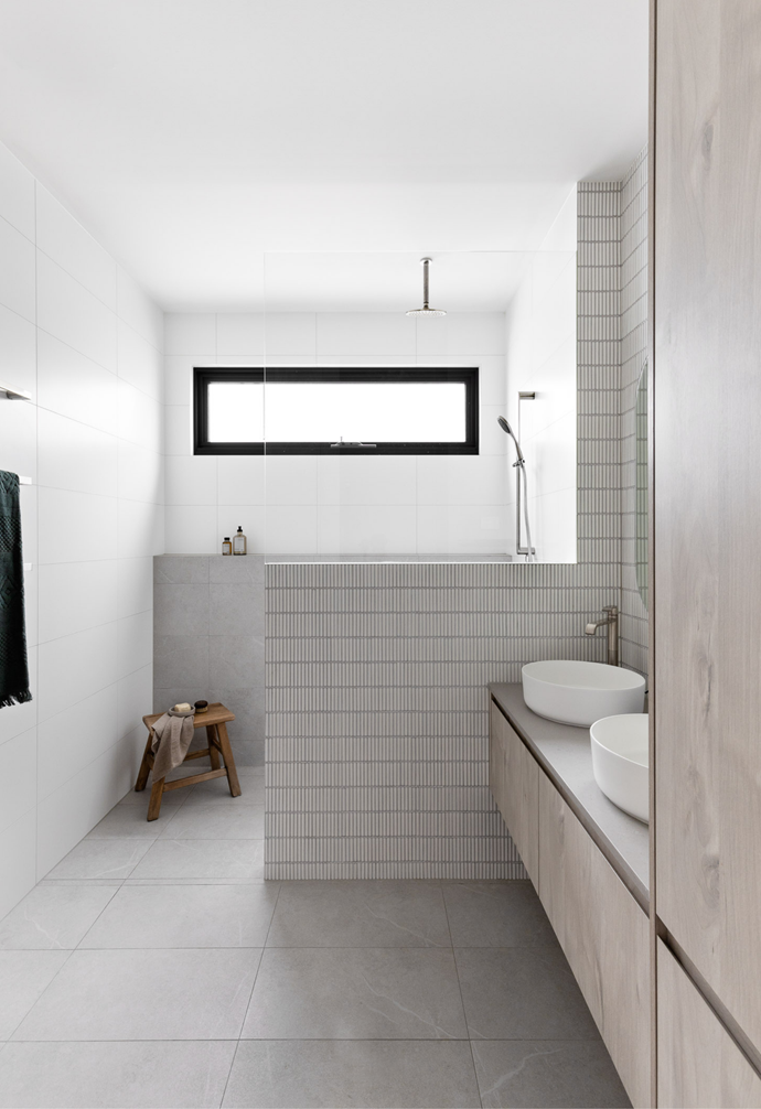 The contemporary bathroom is fit for a family with a double basin vanity, and partitioned shower. Sleek tapware and soft, natural tile colour selections create a spacious feel.