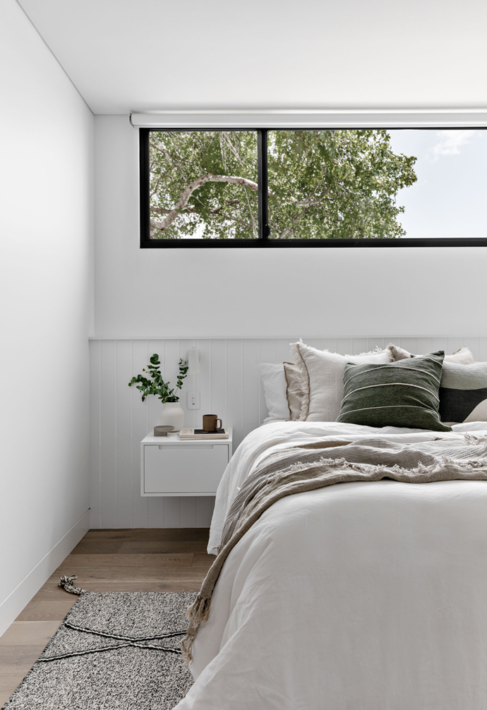 Fabric colours and textures give a light & natural feel to the bedroom. Custom floating bedside table with finger pull draw against v-groove paneling custom bedhead. Fabric colours and natural bedding textures give a light & natural feel to the room.