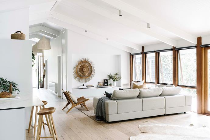 The gorgeously airy living room benefits from huge windows, as well as a fireplace that was already there.