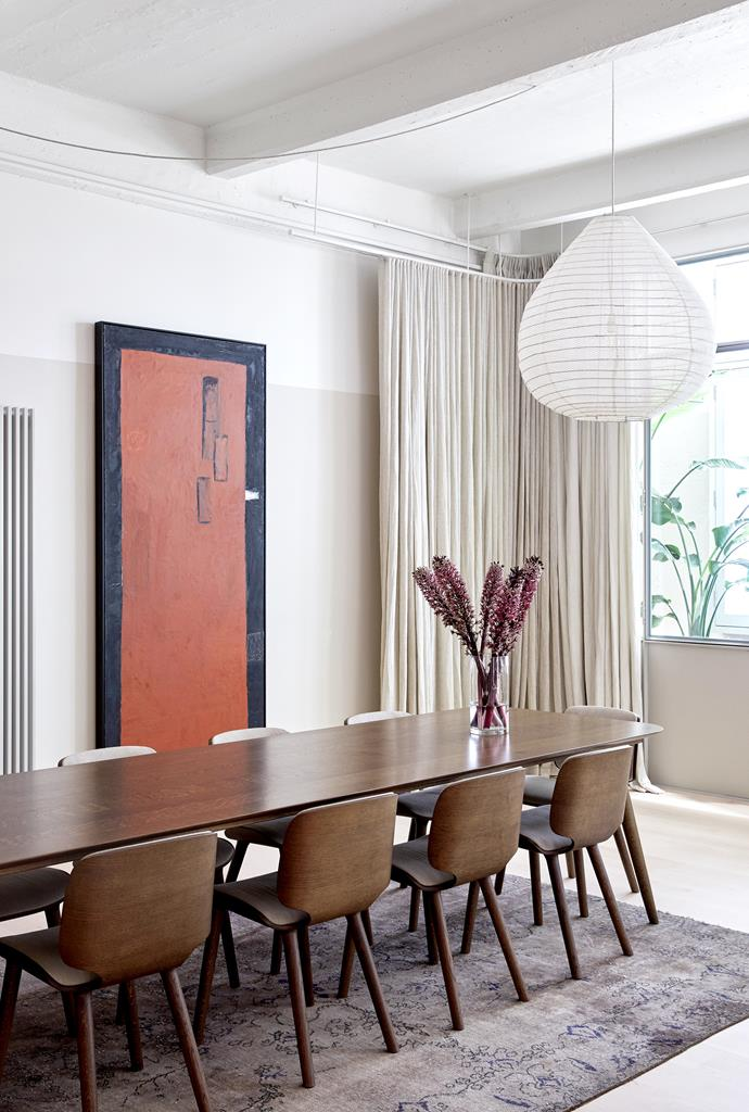 A large artwork by Melbourne artist Mike Nicholls commands the dining area, with its earthy tones reflected in a Moooi 'Zio' oak dining table and 'Nut' oak dining chair by Marcel Wanders from Space. The overdyed Persian rug was purchased in Istanbul.