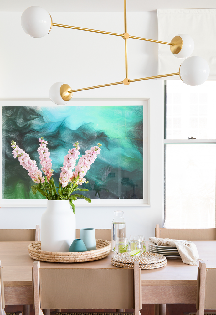 """The deep-sea tones of 'Schwarm Gruen', an Andreas Nicolas Fischer artwork from Otomys, creates a striking backdrop in the [dining area](https://www.homestolove.com.au/relaxed-dining-area-ideas-3675
