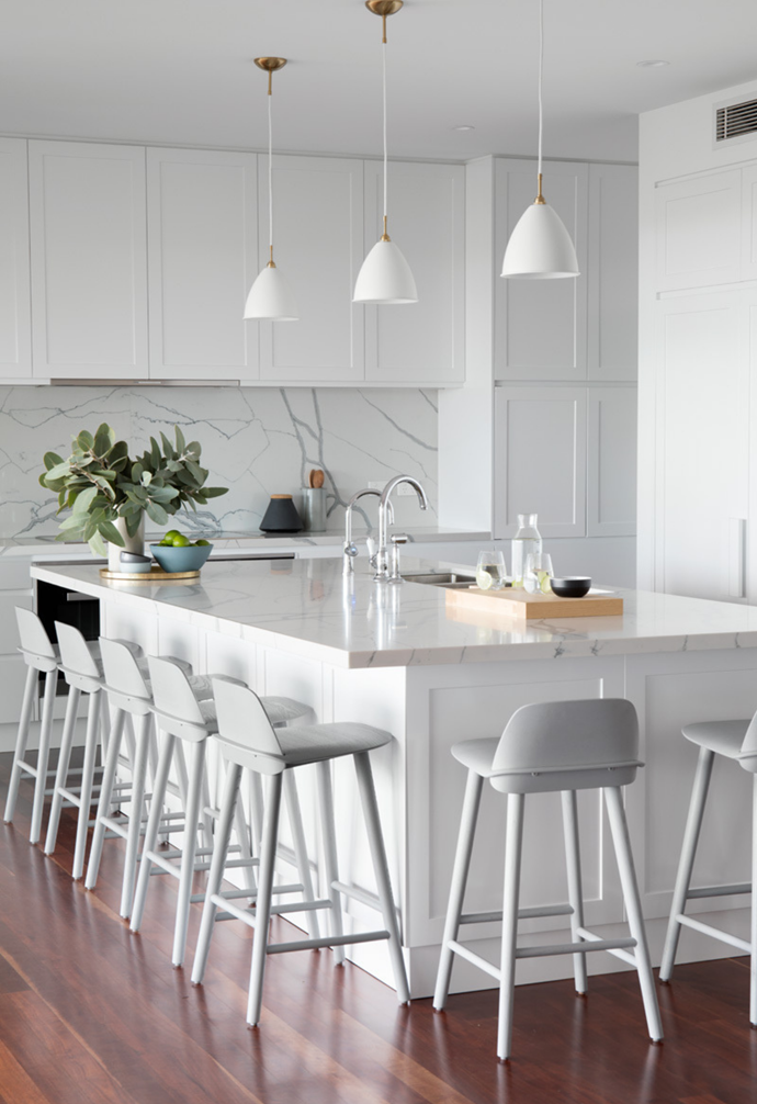 """Since this zone is 'snack central', the benchtops and splashbacks are in Smartstone Statuario Venato – a more practical choice than natural marble. """"It looks like the real thing, but I don't have to worry about staining from beetroot or wine,"""" explains Victoria."""