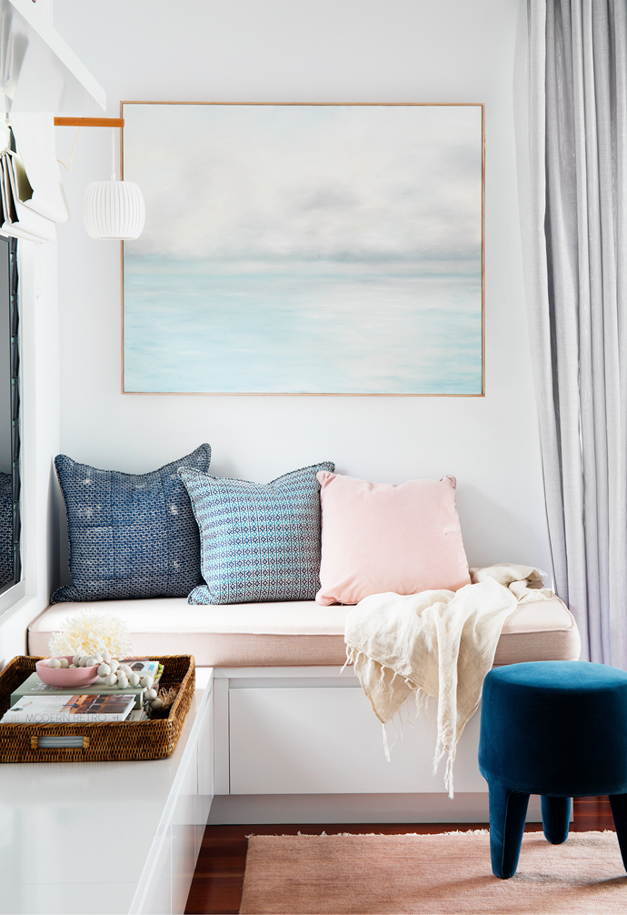 Navy block print cushions from Style Revolutionary, and pink velvet cushion by Berkeley Interiors dress up a reading nook.