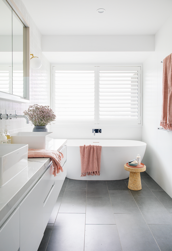 In the ensuite, the custom-made mirror cabinet makes a statement, with two thirds of the frame defined in Dulux Parchment Paper. Aura Home Paros Bath Towels in Pink Clay complete the look. Visit aurahome.com.au.