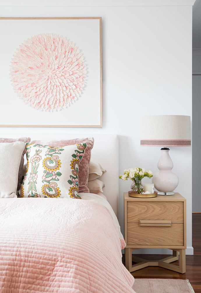 Textures abound in the couple's bedroom, courtesy of a linen upholstered bedhead by Circa 64 and the handcut paper artwork – 'Pink Swan' from Mondocherry hanging above. Atop the bed, custom cushions by Berkeley Interiors in Anna Spiro Textiles' Kandilli and Mokum's 'Bespoke' velvet in Blush draw the eye, as does a 'Double Gourd' lamp from Bragg & Co with custom-made shade on a 'Pearl' bedside table from Zuster Furniture.