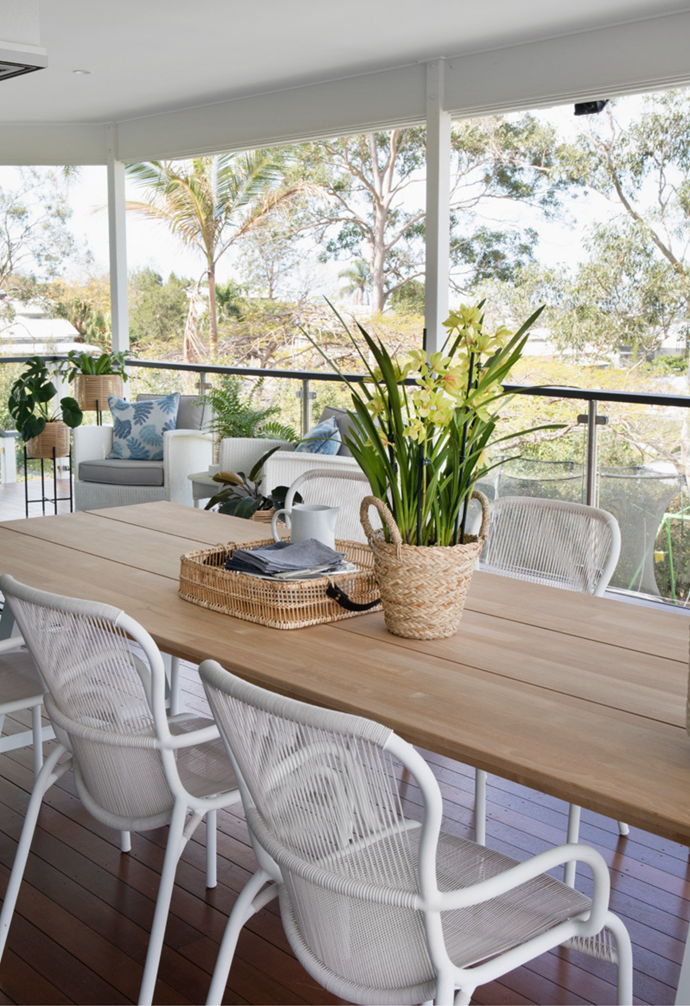 The family often relax on their outdoor dining furniture from Cotswold InOut Furniture.