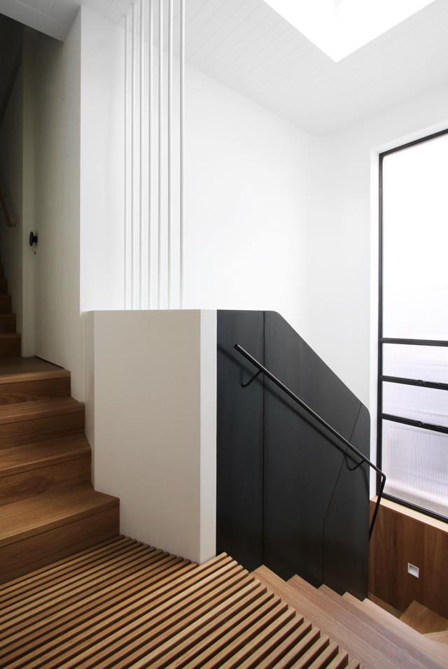 """""""Slatted floors at stair landings allow you to experience the three-storey space from the lowest level to the skylight,"""" say Stanic and Rasmus Architects, who specified a waxed steel plate and custom handrail, a white-steel box and rod screen by All Metal Projects, and blackbutt treads for the circulation space that is now one of this [terrace home's](https://www.homestolove.com.au/terrace-house-renovation-paddington-22202