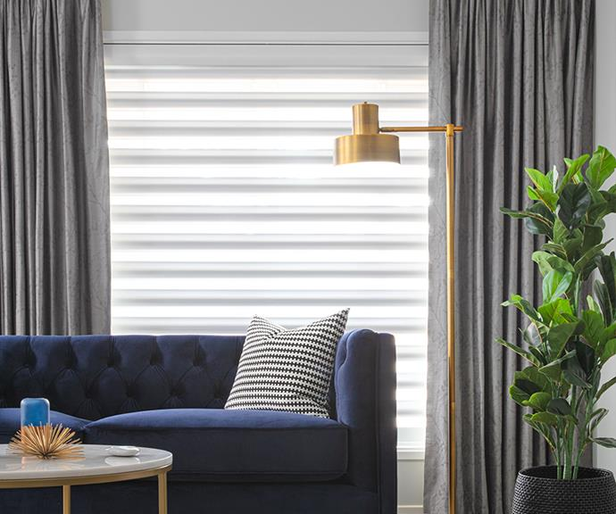 Layered curtains and blinds creates a beautiful design element while diffusing natural night to create a soft glow.