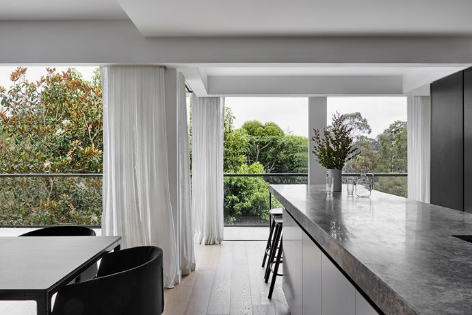 The elongated marble and steel kitchen island caters for entertaining on a grand scale.