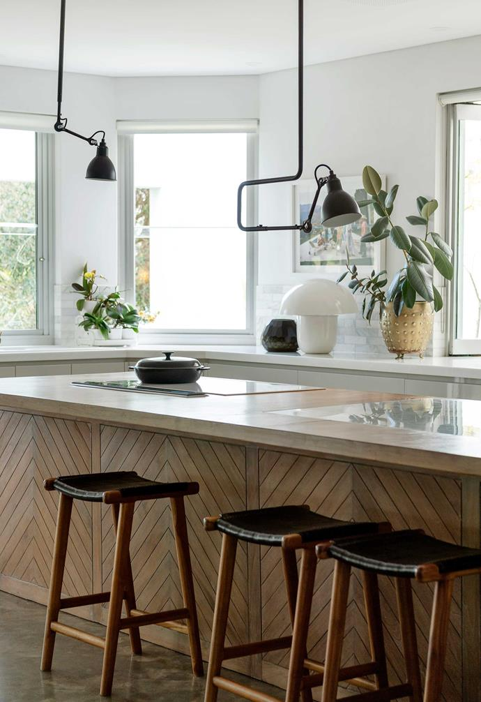 """**Kitchen** Jill is a great cook and wanted a kitchen she'd love to spend time in. She specified herringbone teak for the island front and Carrara marble for the benchtop. Gras N313 pendant lights, [Spence & Lyda](https://www.spenceandlyda.com.au/
