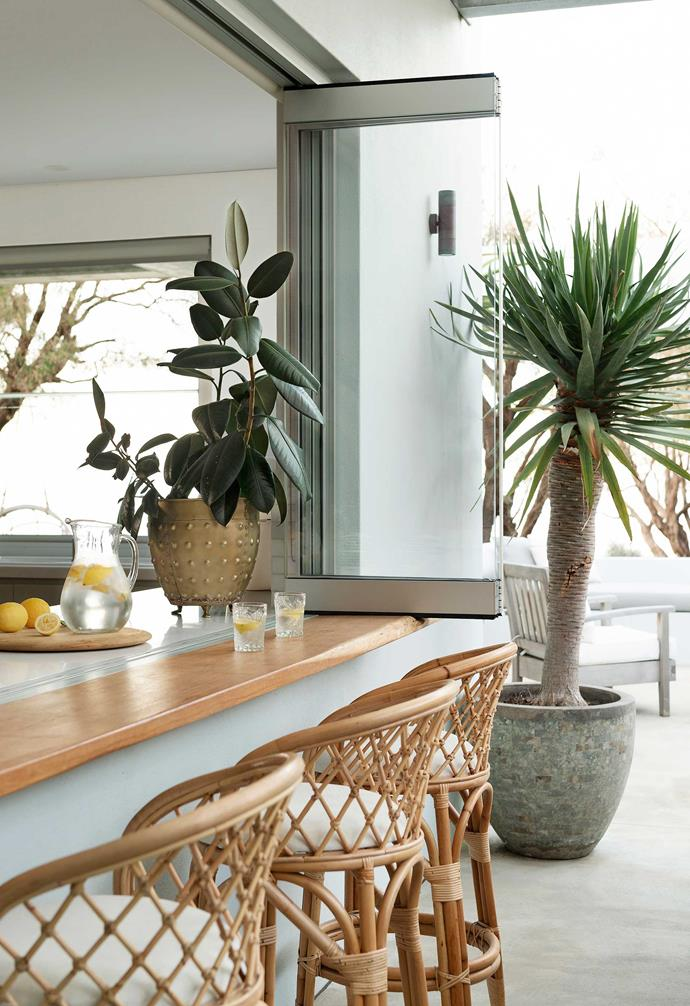 **Coastal cool** Robust materials were selected for the build, and concrete sensibly chosen for both the indoor and outdoor living zones, which means sandy feet fresh from the beach and changeable seaside weather are all welcomed. From the kitchen, bifold windows open onto the perfect perch for a late-afternoon drink – ideal for the owners, who love to host family and friends.