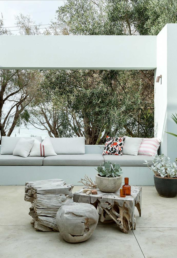 """**Terrace** In the open space overlooking the water are Salur teak armchairs and recycled-teak stumps from [Empire](https://www.empirehomewares.com.au/