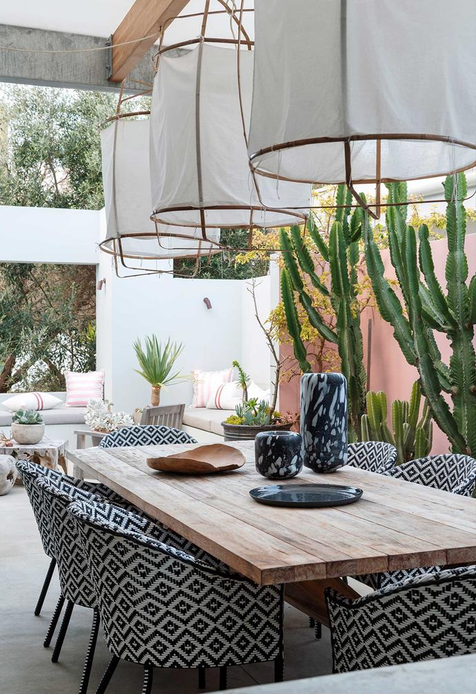 """**Outdoor dining** Adding a blush-pink wall (in a [Dulux](https://www.dulux.com.au/