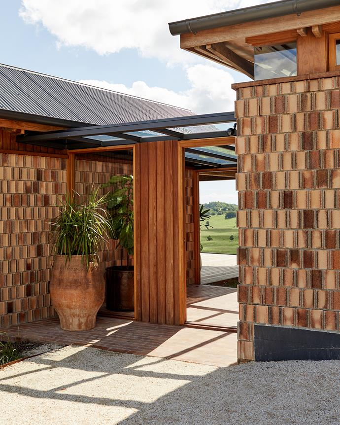 Natural materials play a key role in this home in the Byron Bay hinterland. A mix of stone, concrete and timber – plus this unique brickwork on the exterior walls – adds character and helps connect the home with the landscape.