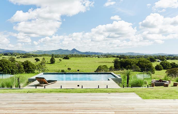 The home is set on a sprawling 16 hectares and is still a working cattle farm. Stepping down, you arrive at a generous deck and Theralux mineral pool. There's also a firepit (at right), which the family uses as often as possible.