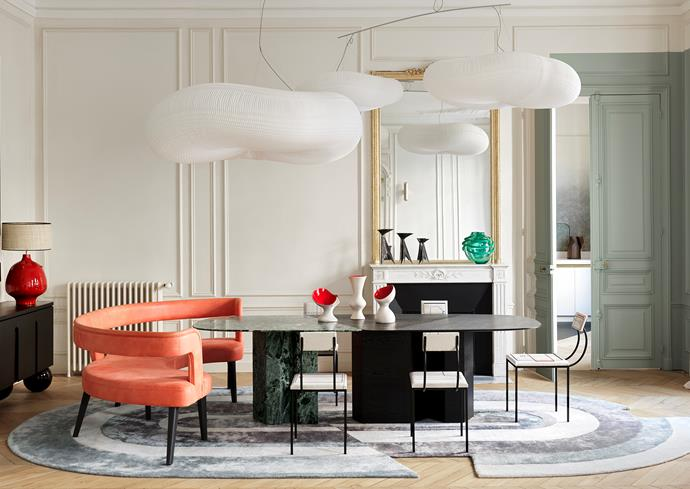 Dining table by Le Berre Vevaud is a 'Cloud Softlight' mobile pendant light with polyethylene shades by Stephanie Forsythe and Todd MacAllen from Molo, spotted by Raphaël Le Berre and Thomas Vevaud at Maison&Objet. 'Bel Air' leather banquette, rug and 'Olbia' sideboard, all by Le Berre Vevaud. Vintage chairs by Pierre Staudenmeyer and Julio Villani from Galerie Mouvements Modernes. Ceramic vases by Pol Chambost. Ceramic lamp on the sideboard by Atelier Dalo. Bronze candlesticks by Lynn Chadwick. 'Tesoro' Murano glass vase by Pierre Gonalons.