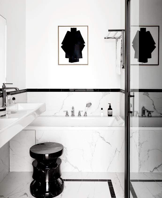 A Furoshiki artwork by Pierre Bonnefille hangs in the master ensuite. 'Barth' stool in Nero Marquina marble by Le Berre Vevaud. Tapware from Paini France.