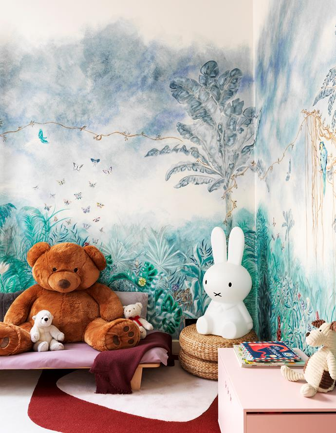 The children's bedroom comes alive with a rug designed by Le Berre Vevaud and a wall fresco by Céline Dewavrin.