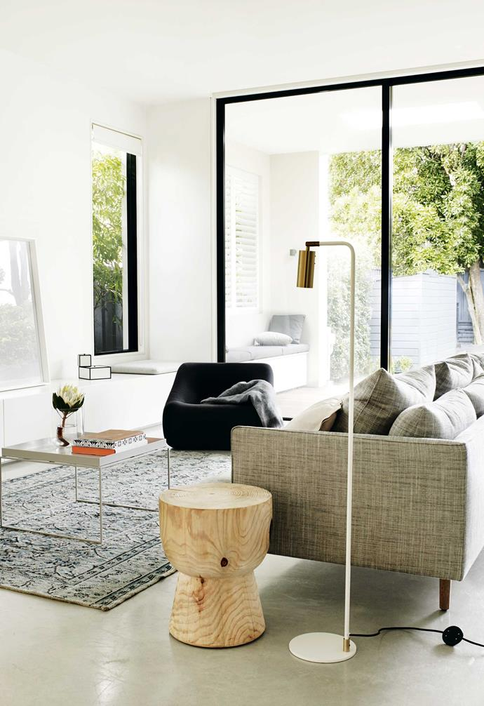 **Living area** Black-framed glass panels bring definition to this zone. The calm feel is thanks to a sparse palette – the pared-back tones are in line with owners Dana and Avi's minimal style.