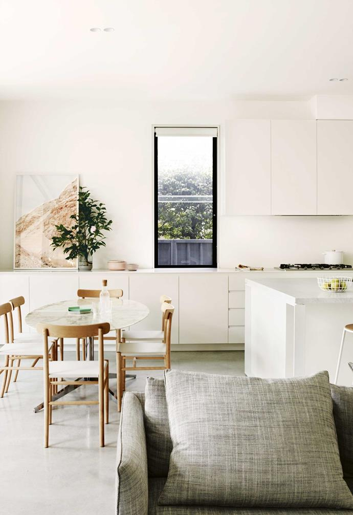 """**Open-plan living** Sleek joinery, designed by firm [Pipkorn & Kilpatrick](https://www.pipkornkilpatrick.com.au/