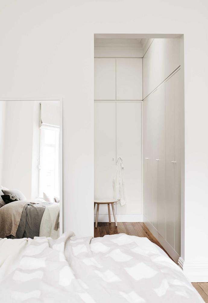**Master suite** Plans for the renovated home included knocking the master bedroom through the second bedroom. Leaning a mirror against the wall gives the bedroom a more relaxed look and lets you play with the angle light is reflected at.