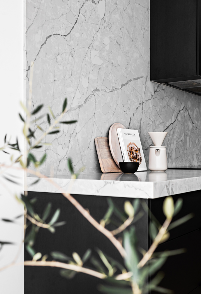 """Talostone in Super White adds luxe appeal to the [kitchen benchtop](https://www.homestolove.com.au/15-of-the-best-kitchen-benches-13723 target=""""_blank"""")."""