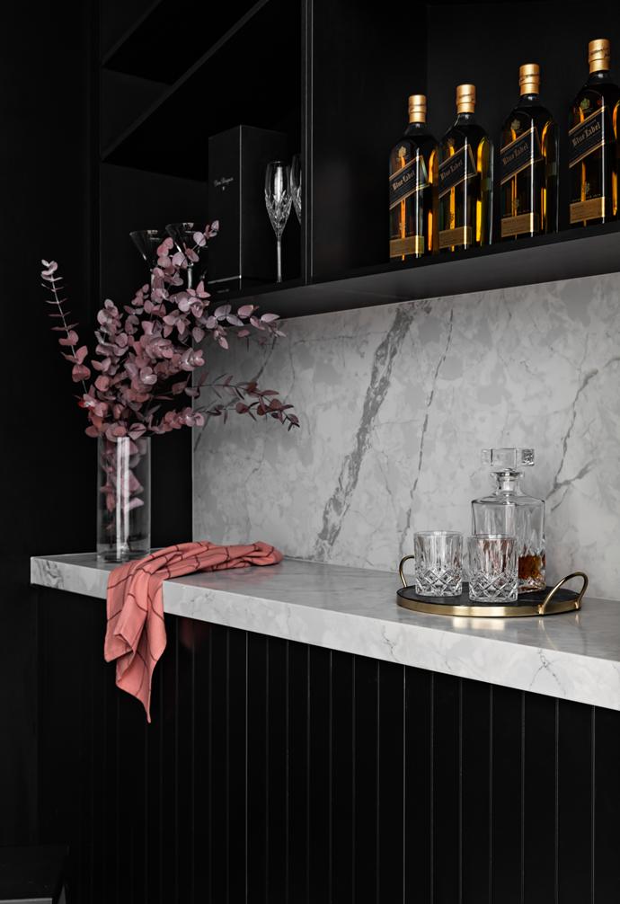 A sleek bar is ready for entertaining.