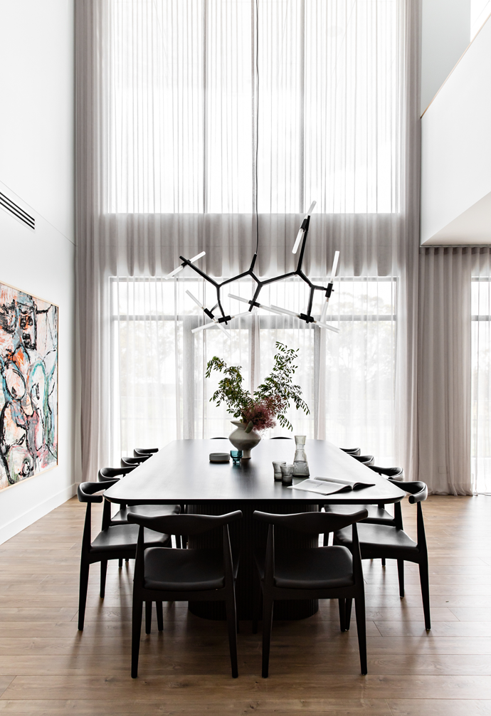 The American oak table was custom-made, its rich black stain providing a foil for the vivid artwork, Farmer by Remy Prideaux.