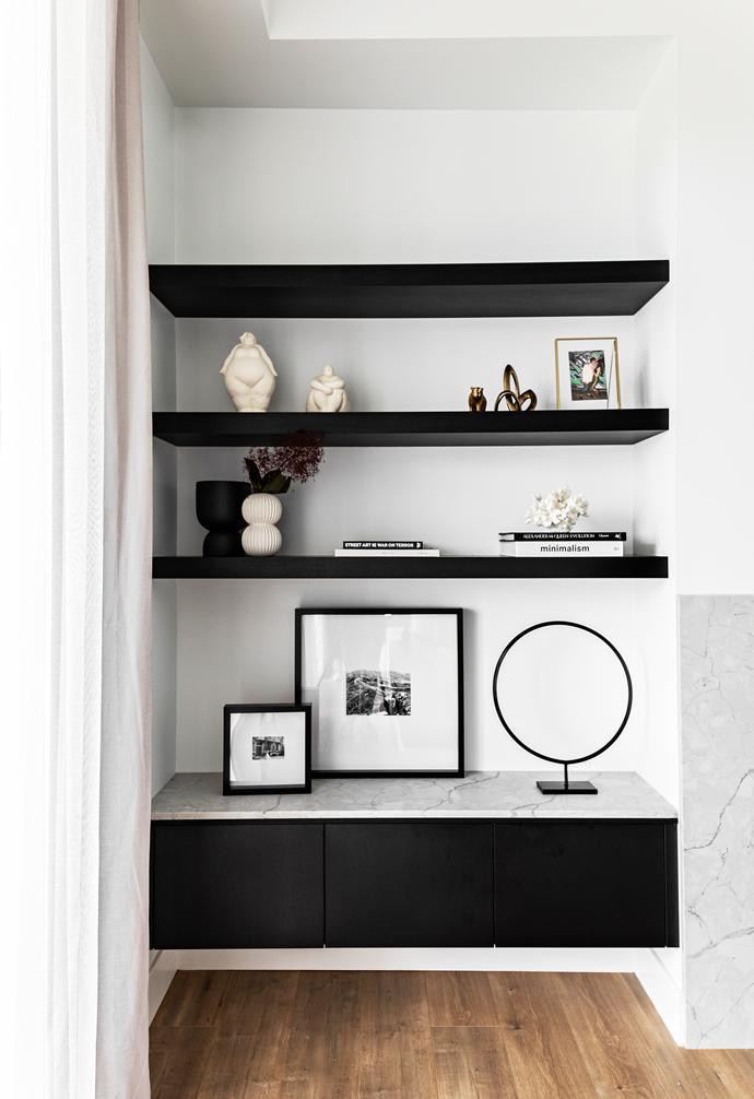 Custom shelving in Polytec Woodmatt Black epitomises stylish storage.