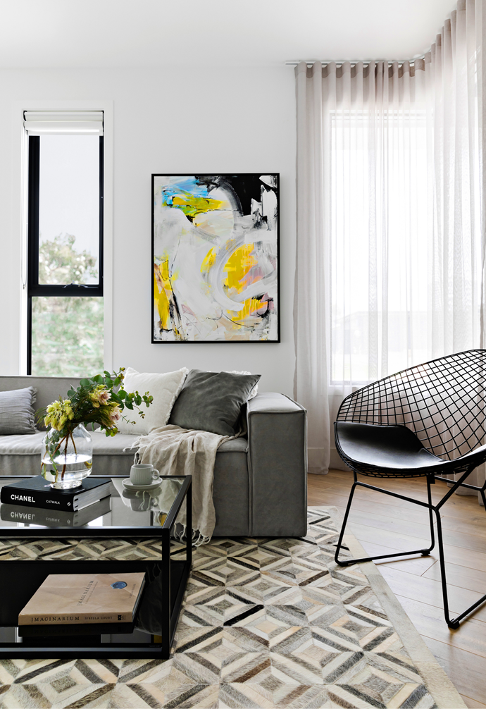 If guests arrive, one might pull up the occasional chair – a replica Harry Bertoia 'Diamond' from Replica Furniture – and admire the vibrant swirls of Heaven, another piece by South Australian artist Remy Prideaux.