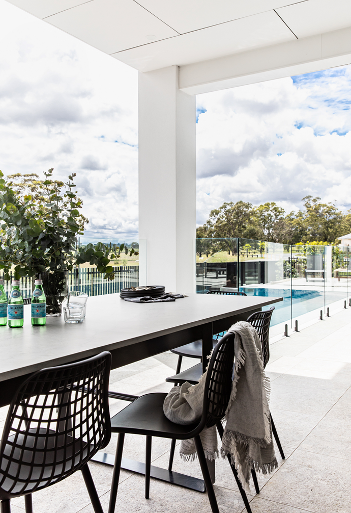"""Entertaining is a breeze in this chic outdoor area, which overlooks gorgeous greenery. The pool, constructed by King Homes NSW, is the main drawcard. """"We live 50 kilometres from the CBD, which means it gets hot,"""" says Veronica. """"The pool's been a very worthwhile investment."""""""