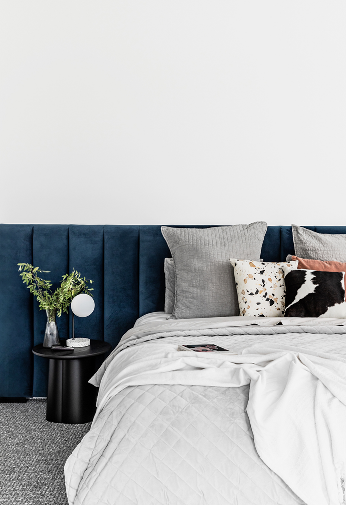An upholstered bedhead by BB Furniture is the hero of the guest bedroom.