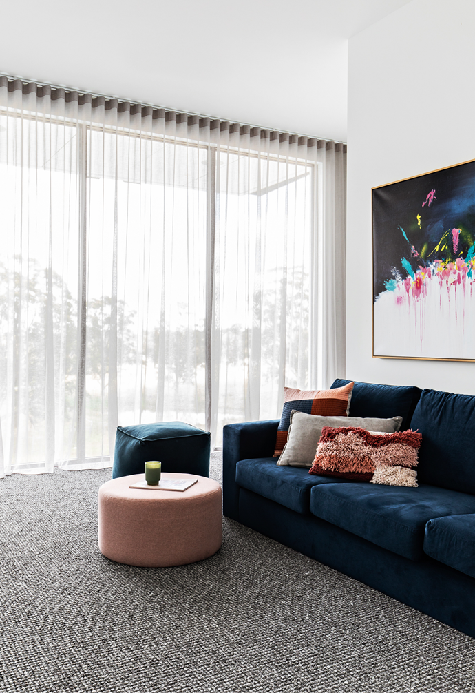 This open-plan zone on the second-storey landing might often be strewn with toys, but it's still inherently stylish, kitted out with a custom-made sofa by BB Furniture, an 'Omni' ottoman from Temple & Webster and a Brenda Meynell artwork.