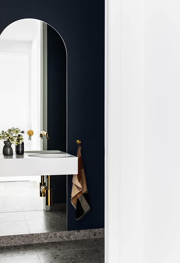 The powder room features a door painted in Dulux Rainmaker.