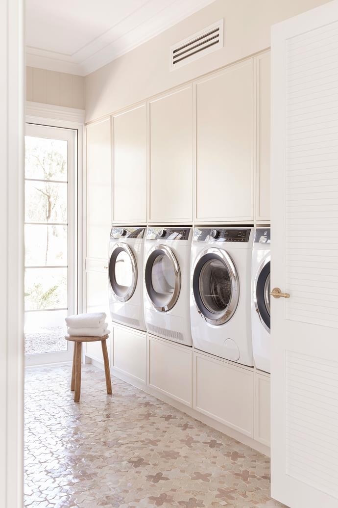 """The laundry is well-equipped for family life with a panel of Electrolux [washers and dryers](https://www.homestolove.com.au/best-washer-dryer-combo-australia-21593