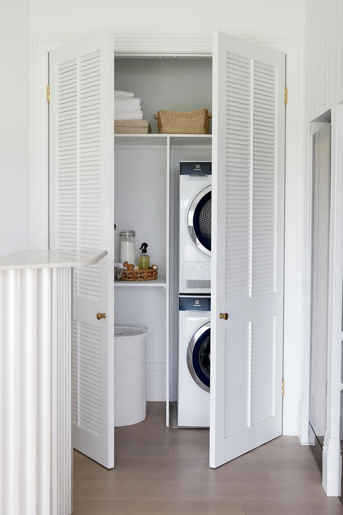 """Tucked away behind the statement bar is a sleek [European laundry](https://www.homestolove.com.au/european-laundry-design-19356