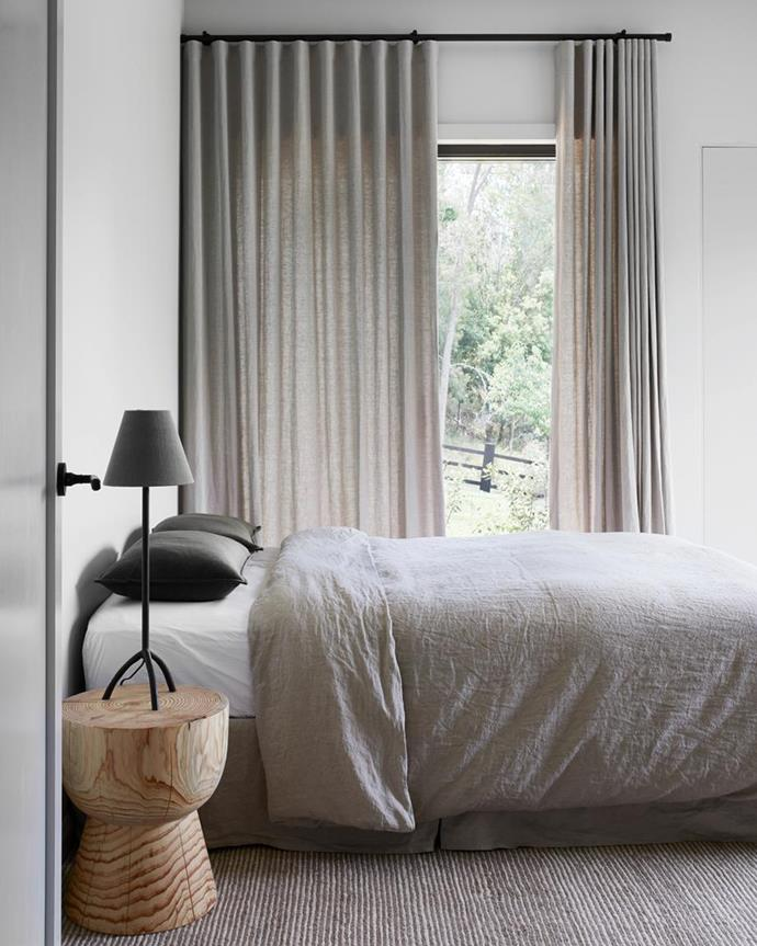 """Linen is often used in summer, but it's actually a great option for winter bedding as it regulates body temperature and feels heavier than other fabrics. In this [modern farmhouse style weekender in the NSW Central Coast hinterland](https://www.homestolove.com.au/modern-farmhouse-style-weekender-21723