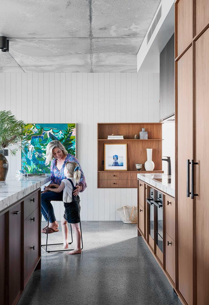 """**Kitchen** """"We wanted to maintain a light-filled space in the stairwell and achieved this with the floating oak stair treads,"""" adds Kirsty. Flooring, [Polished Concrete Floors Australia](https://polishedconcretefloorsaustralia.com/ target=""""_blank"""" rel=""""nofollow""""). Opa print by Kate Mayes, [Greenhouse Interiors](https://greenhouseinteriors.com.au/ target=""""_blank"""" rel=""""nofollow""""). [Polytec](https://www.polytec.com.au/ target=""""_blank"""" rel=""""nofollow"""") 'Florentine Walnut' cabinetry by Mivis Joinery, with [Lo & Co](https://www.loandcointeriors.com.au/ target=""""_blank"""" rel=""""nofollow"""") 'Alpha' door knobs and 'Kintore' appliance pulls."""