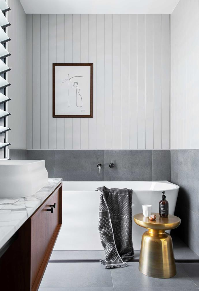 """**Bathroom** VJ panels painted [Dulux](https://www.dulux.com.au/ target=""""_blank"""" rel=""""nofollow"""") Winter Terrace contrast with the November wall and floor tiles in Rain from [Classic Ceramics](https://www.classicceramics.com.au/ target=""""_blank"""" rel=""""nofollow""""). Bath, [Highgrove Bathrooms](https://www.highgrovebathrooms.com.au/ target=""""_blank"""" rel=""""nofollow""""). Martini side table, [West Elm](https://www.westelm.com.au/ target=""""_blank"""" rel=""""nofollow""""). Palmary print, Bibi Ana + Co."""