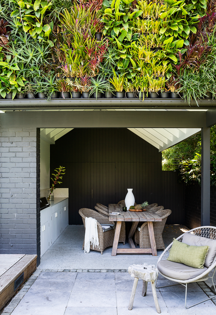 Exteriors in Dulux Monument create an inviting outdoor dining area. Try Domayne for similar furniture.